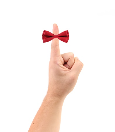 Red bow on finger. Isolated on a white background. photo