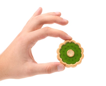 hand jam: Hand holds biscuit with kiwi jam. White background.