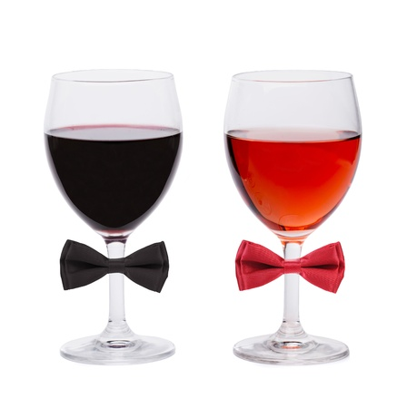 Glasses of wine decorated with bows  White background  photo