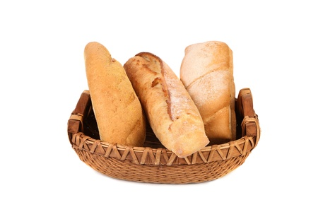 Composition of breads in basket on a white background photo