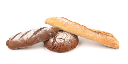 boulangerie: Two brown and one white breads. Isolated on a white background.