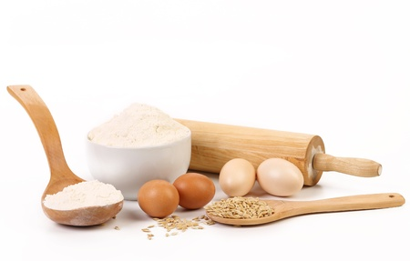 Composition of flour and eggs. Isolated on a white background. photo
