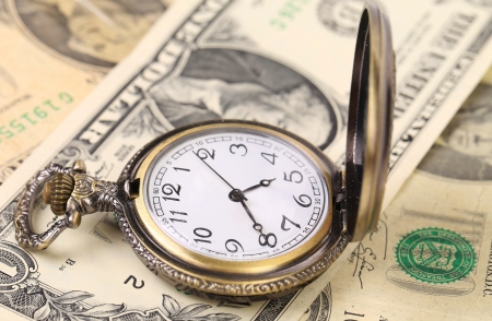 Vintage watch and dollars on a white background photo