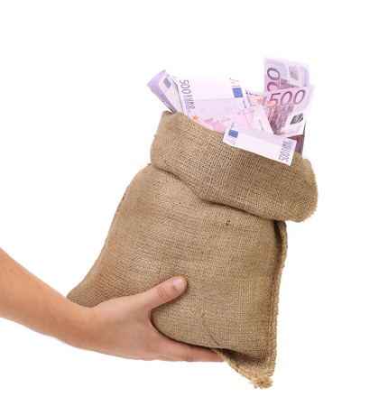 rescheduling: Hand holding bag with many euro banknotes