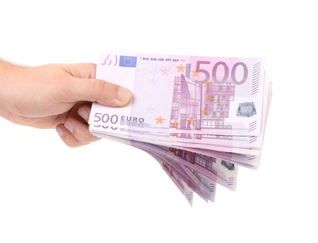 Hand holds five hundreds euros banknotes. Isolated on a white background. photo