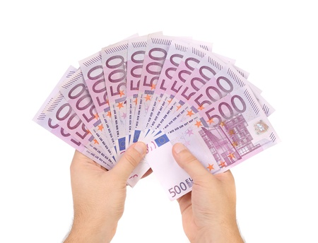 Hands holding 500 euros banknotes isolated on a white Stock Photo