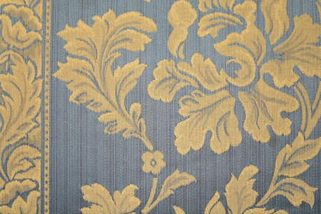 Blue rug with yellow flowers. Whole background. Stock Photo