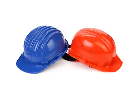 Hard hat of different colors like yin and yang. Isolated on a white background.