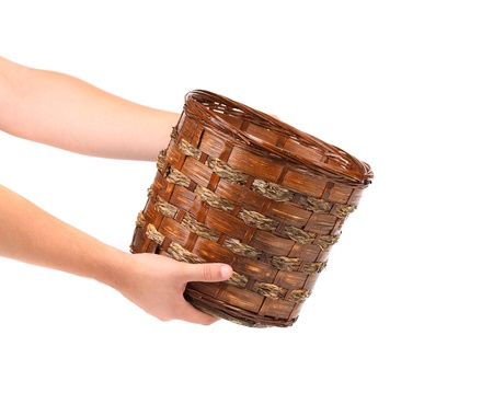 Hand holds basket. Isolated on a white background. photo