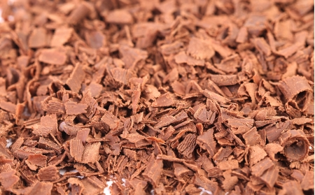 Grated milk chocolate. Close up. Background. Textures photo