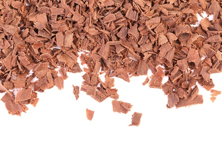 Grated chocolate. There is white space. White background. photo