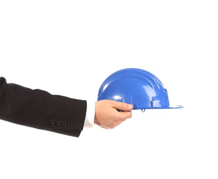 Hand holding blue hard hat isolated on white background photo