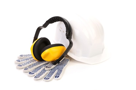 Protective ear muffs and gloves. Isolated on a white background. Stock Photo