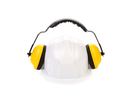Protective ear muffs and hard hat. Isolated on a white background. photo