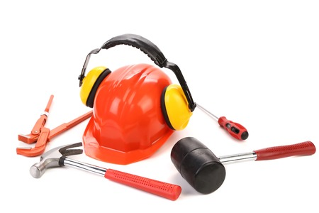 hard hat and ear muffs with tools isolated on white background photo