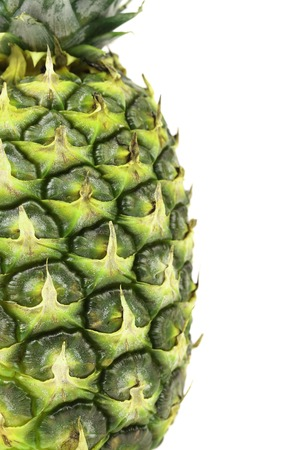 Close up of a pineapple. Isolated on a white background. Space for text. photo