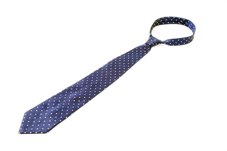 Blue tie with white speck. Isolated on a white background. photo