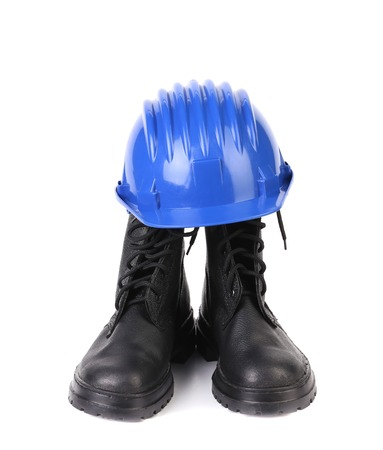 ppe: Hard hat and working boots. Isolated on a white background. Stock Photo