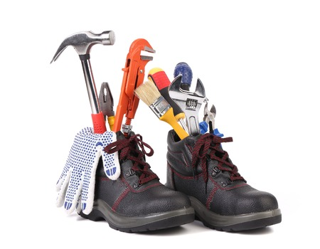 alligator wrench: The building tools and boots. Isolated on a white background.