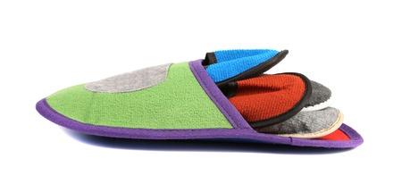 houseshoe: Colourful slippers into big slipper. Isolated on a white background.