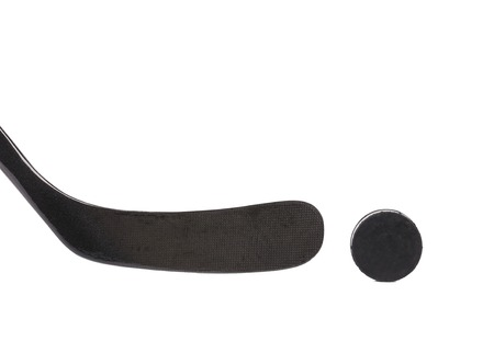 Black ice hockey stick and puck. Isolated on a white background. photo