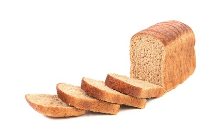 Sliced brown bread isolated on white photo