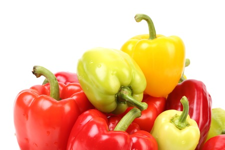 Multi-colour peppers. Isolated on a white background. photo
