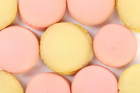 Background of seven various macaron cakes. Close up. photo