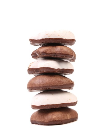 kiss biscuits: Stack of heart shape chocolate meringues. Isolated on a white background.