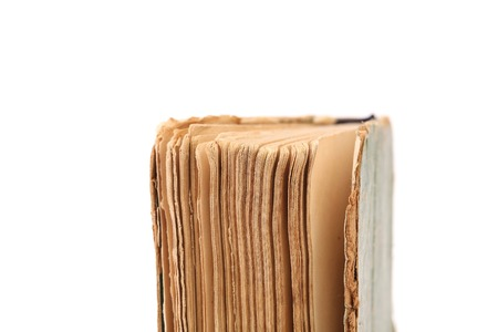 Binding of old book. Close up. Isolated on a white background. photo