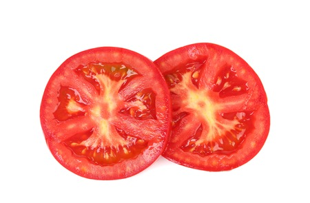 Fresh slices of tomato on a white background photo