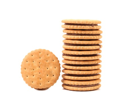 Stack of cookie biscuits with filling. Isolated on a white background photo