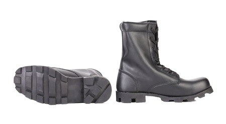 treads: Black boots with rough treads.  Stock Photo