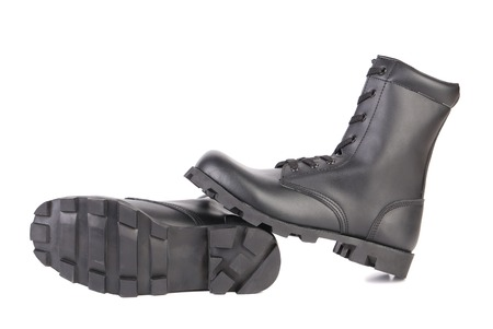 Pair of black boots with rough treads.  Stock Photo - 22477133