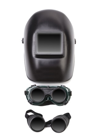 blacked: Welding mask and two glasses. Isolated on white background.