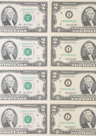 Close up of two-dollar bills. Whole background. photo