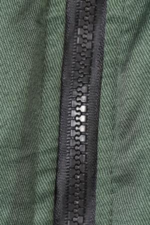 Close up of plastic zipper. Isolated on white background. photo