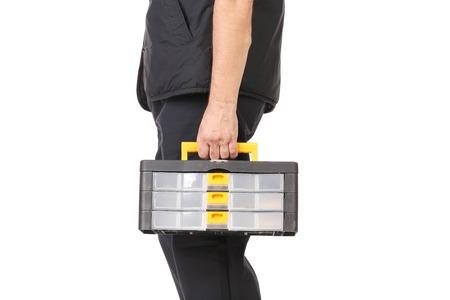 Man holding plastic tool box. Isolated on white background. photo