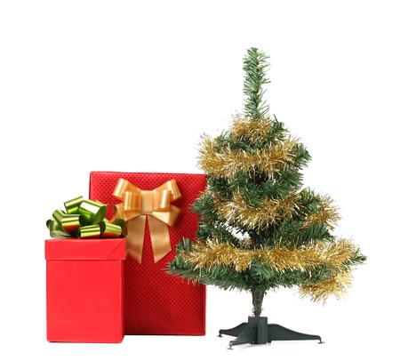 Christmas tree with two present boxes.  photo