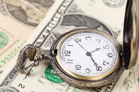 financial assets: Pocket watch with financial assets.