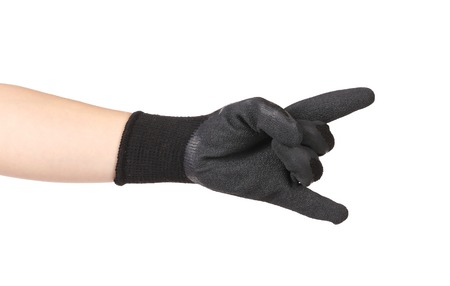 sternly: Rubber protective glove shows rock sign. Isolated on a white background.