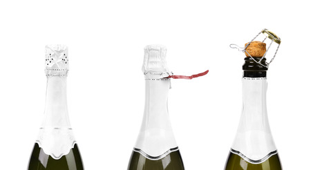 Three steps of opening champagne bottle  Isolated on a white background  photo