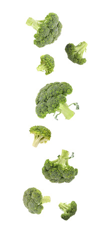 Fresh vibrant green broccoli falling  Isolated on a white background