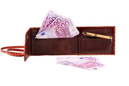Five hundred euro bill in open brown purse. Isolated on a white background. photo