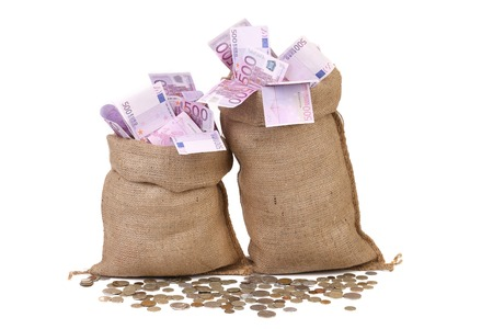 Two full sacks with money and coins. Isolated on a white background. photo