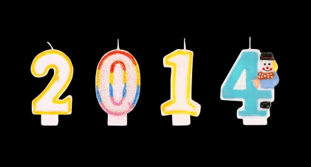 Happy new year 2014 colorfull candles number  Isolated on a black background  photo