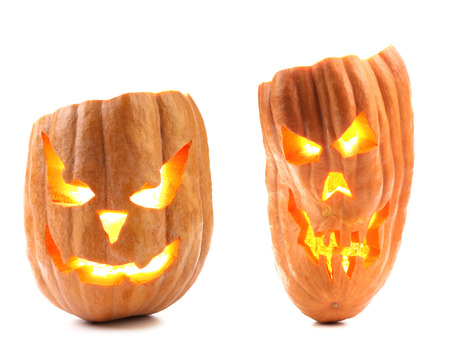 Halloween pumpkin with scary evil faces  Isolated on a white background  photo