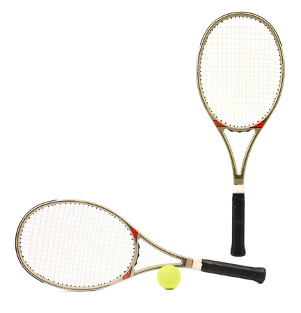 Two sport tennis rackets and yellow ball  Isolated on a white background  photo