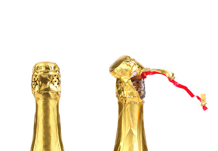 Champagne bottle closed and opened muzzle  Isolated on a white background  photo
