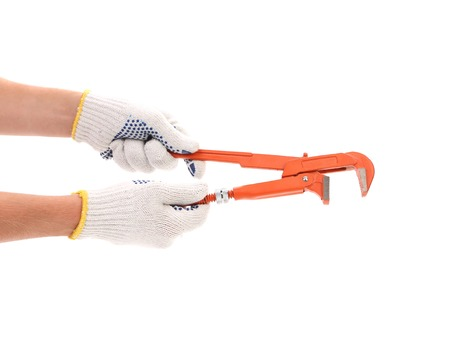 Hand in white gloves holding wrench  Isolated on a white background  photo
